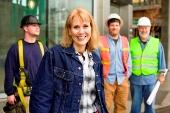 Image of various men and women in work clothes.